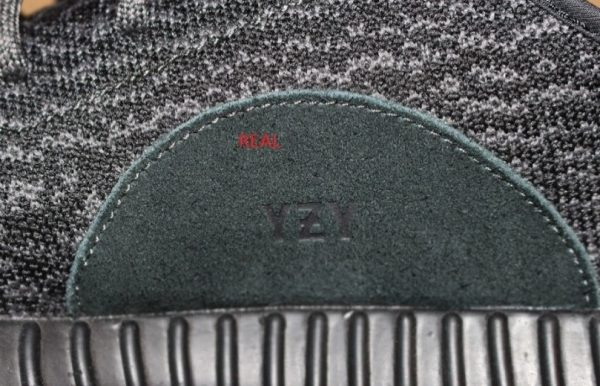 Real Vs Fake The Embossing 2 Yeezy 350 Boost Pirate Black
